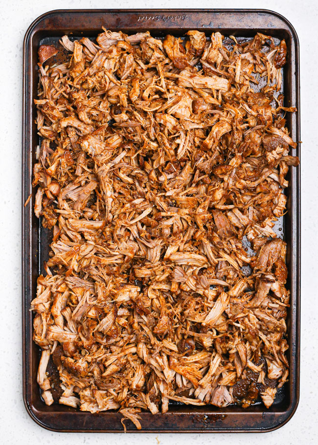 a baking sheet with pulled pork