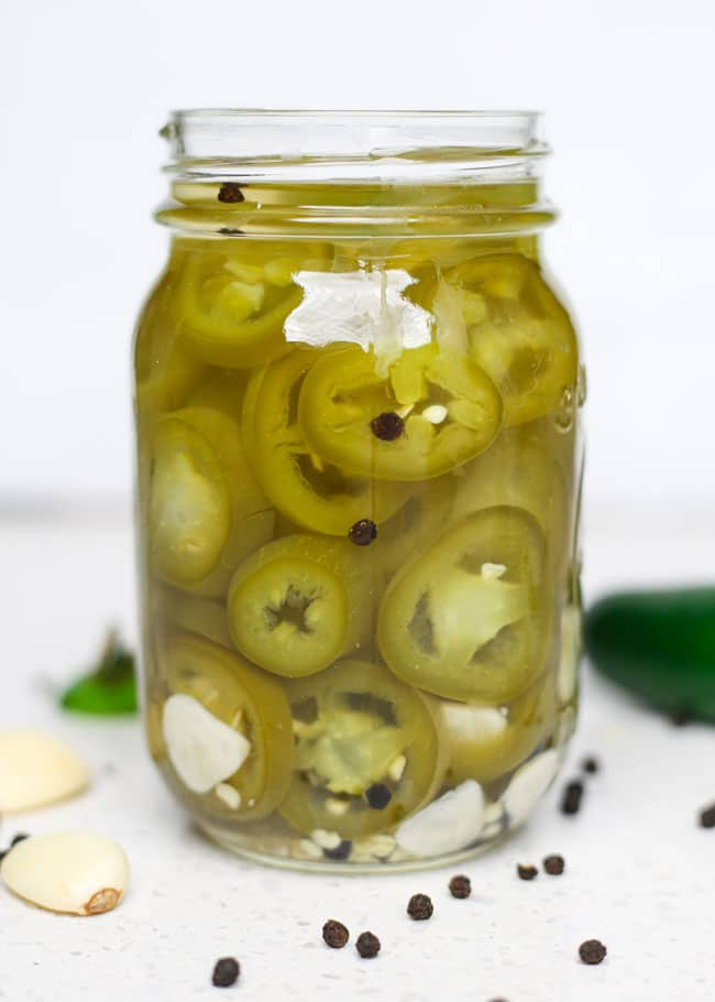 a jar of pickled jalapeno peppers