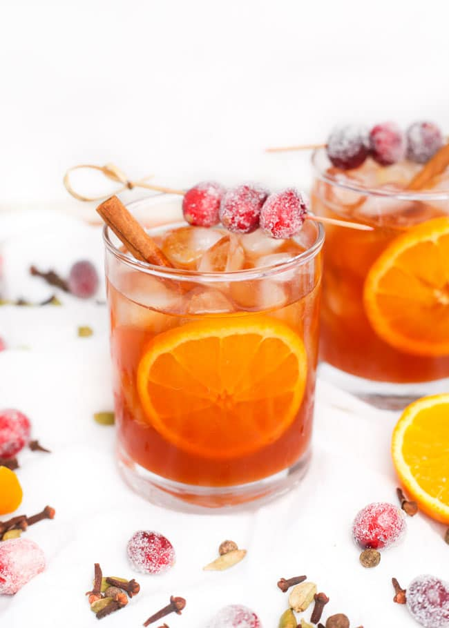 two glasses of cranberry cider