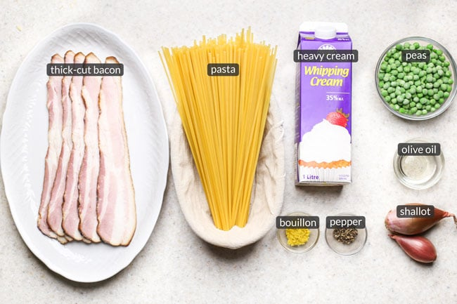 ingredients for creamy pasta with bacon and peas