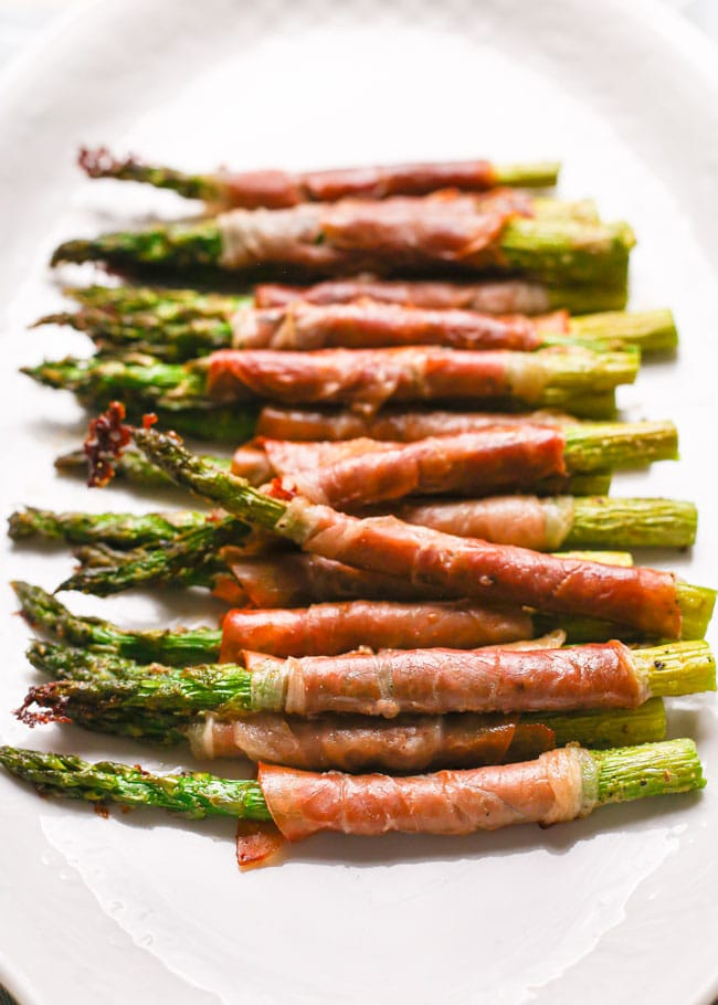 a platter of prosciutto wrapped asparagus