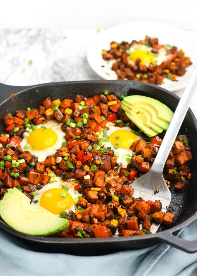 sweet potato hash in a skillet with a spatula