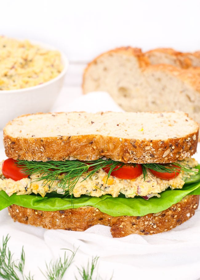 a no-tuna salad sandwich with tomatoes, dill, and lettuce.