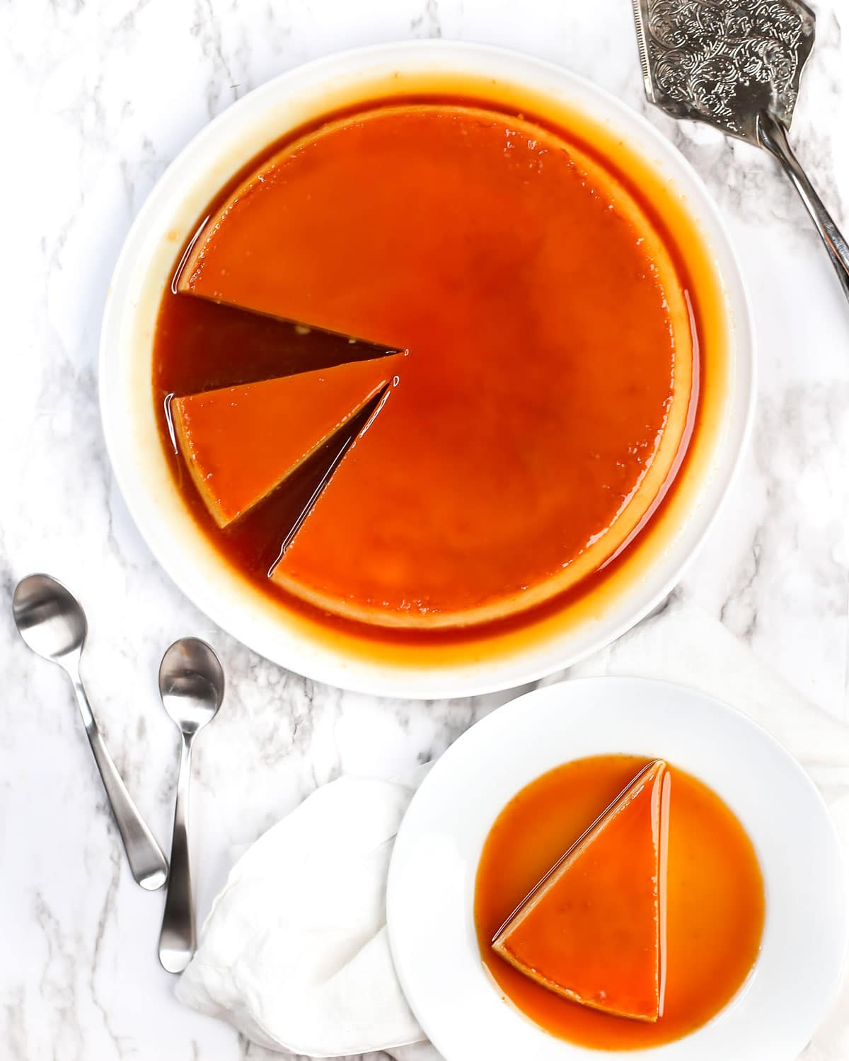overhead photo of flan or creme caramel with a slice served on a plate