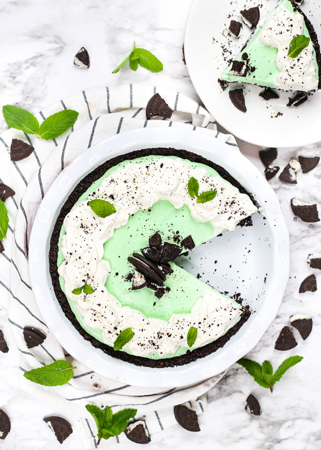 overhead photo of a grasshopper pie with a slice taken from it