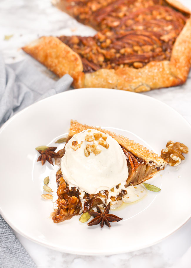 a slice of pear galette with a scoop of ice cream