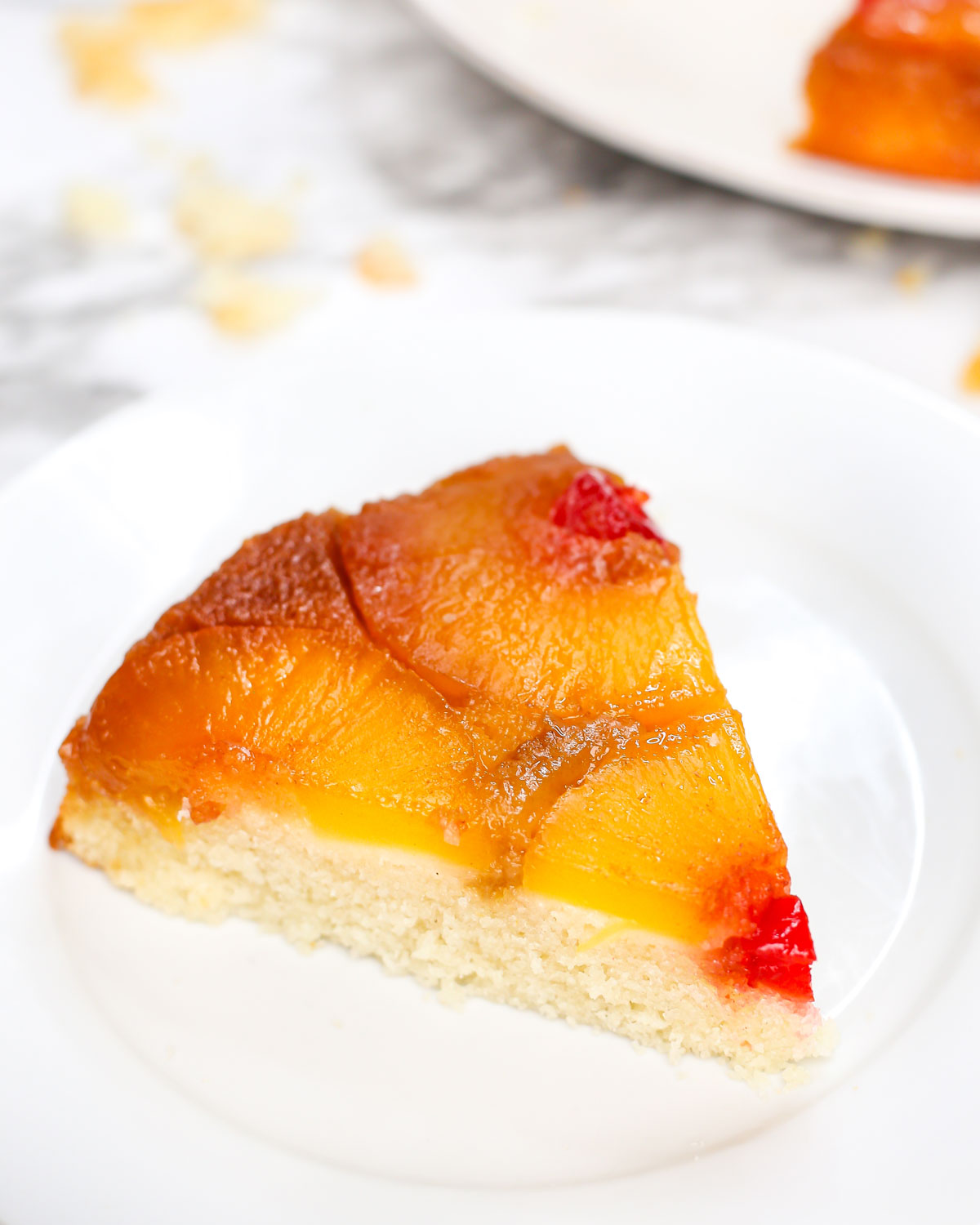 a slice of pineapple upside down cake on a plate