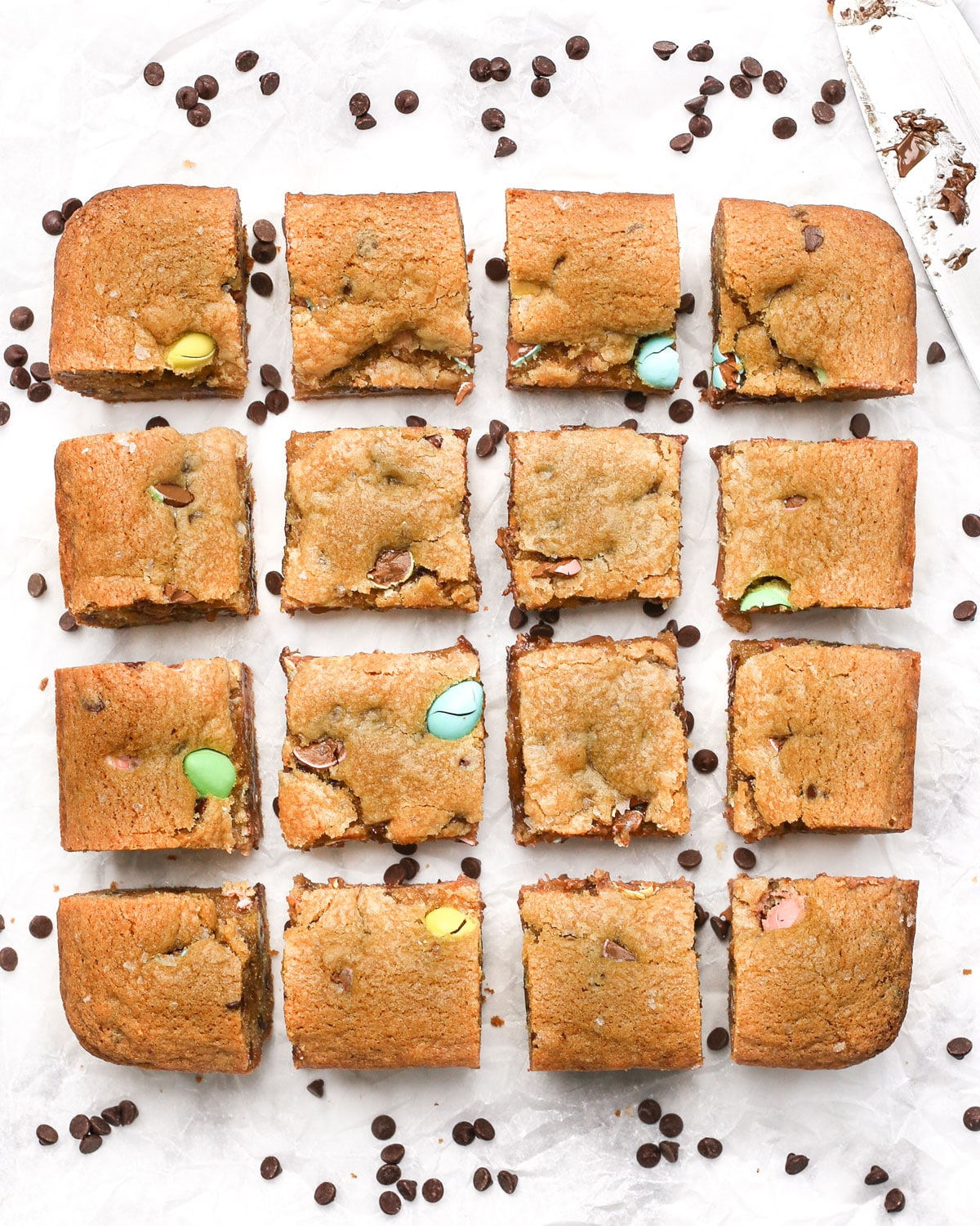 overhead photo of mini egg cookie bars cut into squares