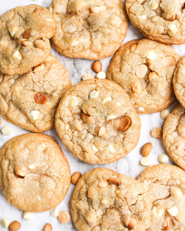 a pile of white chocolate macadamia nut cookies