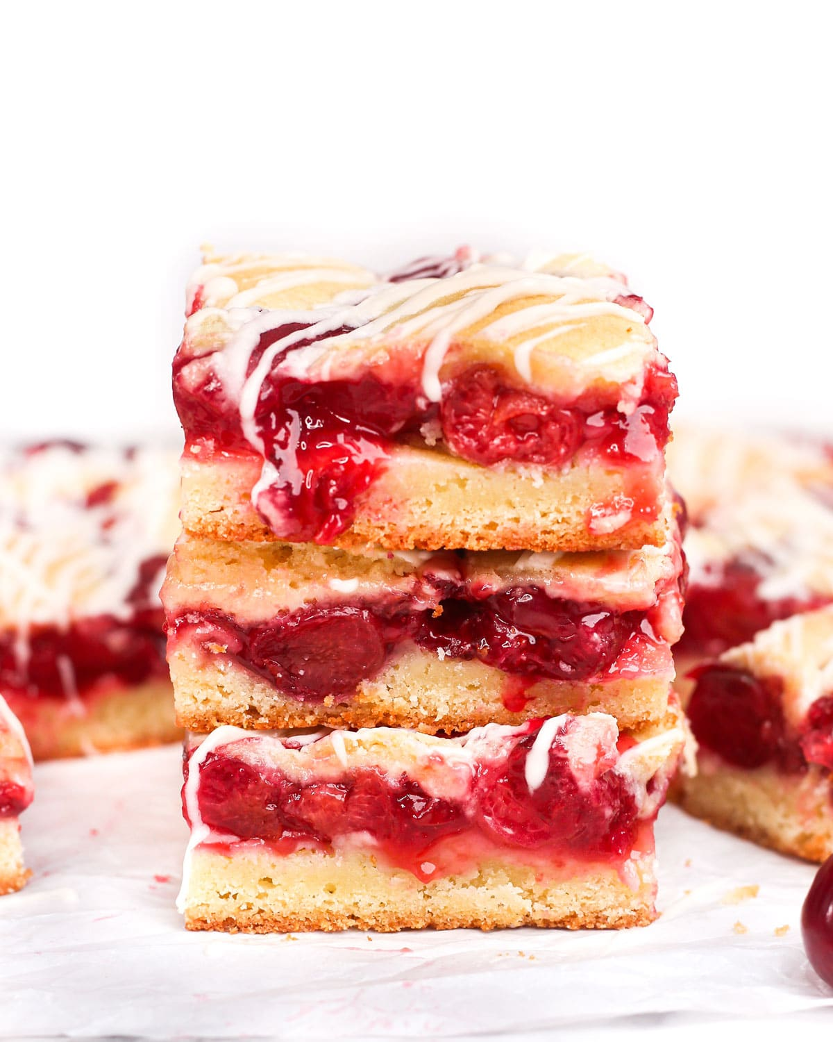 three homemade cherry pie bars stacked on top of each other