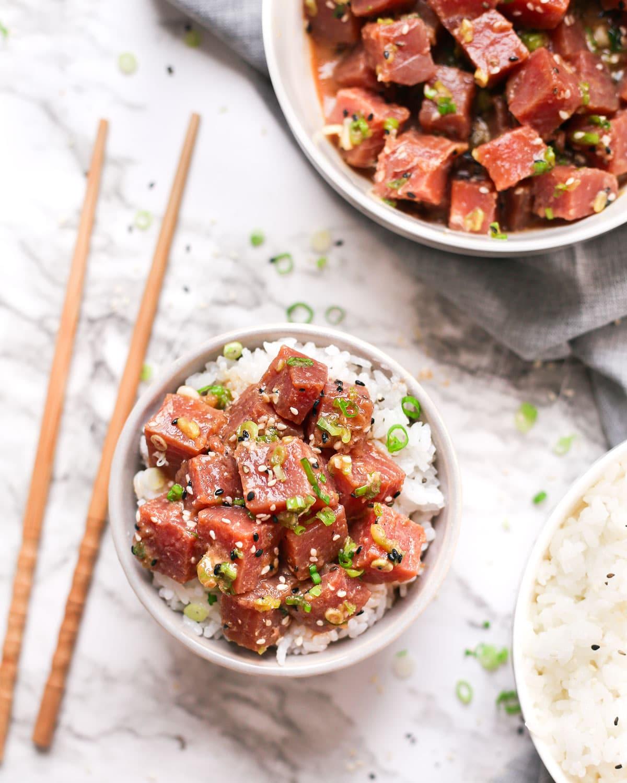 a tuna poke bowl served with rice